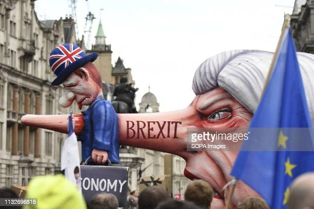 An effigy of Prime Minister Theresa May seen passing by Trafalgar Square during the demonstration Over a million people marched peacefully in central...