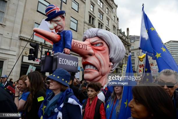 An effigy of Prime Minister Theresa May seen passing by Trafalgar Square during the protest Over a million people marched peacefully in central...