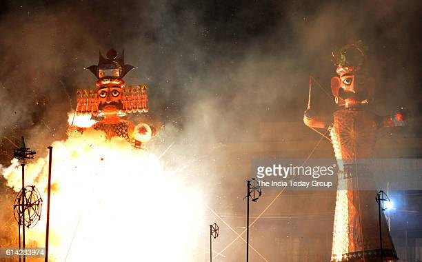 An effigy of Ravan is burnt during Ramlila on the occasion of Dusshera in Delhi