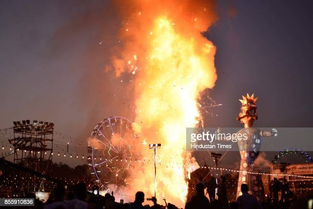 An effigy of Ravana burns during the Dussehra festival celebration at Lal Quila Grounds on September 30 2017 in New Delhi India Dussehra known as...
