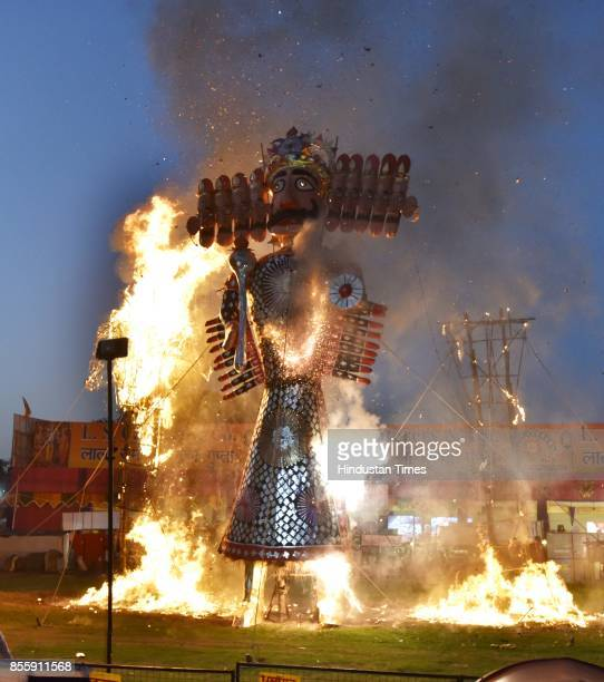 An effigy of Ravana burns during the Dussehra festival celebration organised by Shri Dharmik Leela Committee at Lal Quila Grounds on September 30...