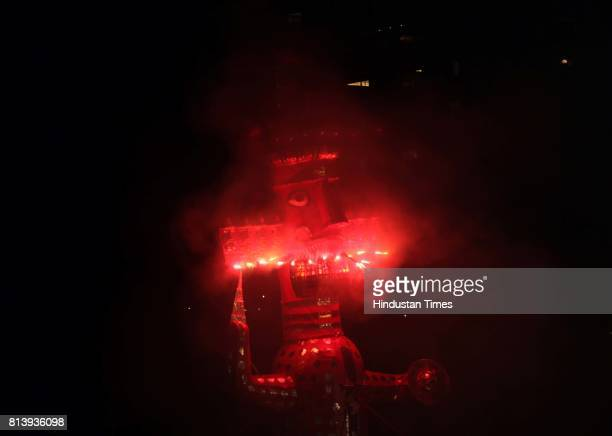 An effigy of Ravana goes up in flames marking the end of Dussehra festival at Girgaum Chaupati in Mumbai