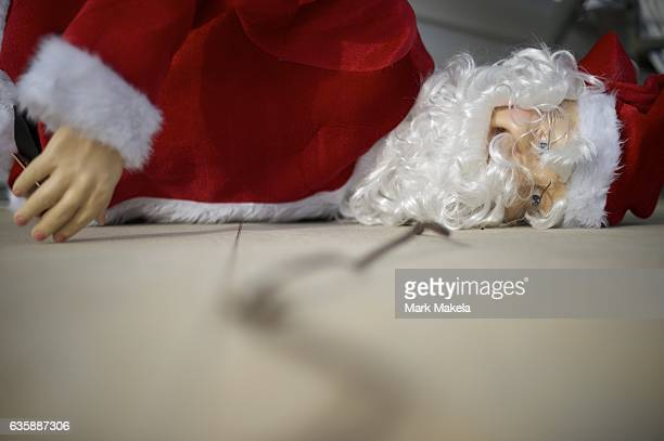 An effigy of Santa Claus lies on the ground on the front porch of a residence December 16 2016 in Hershey Pennsylvania According to a 2013 Pew...
