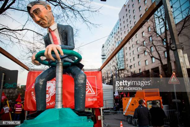 An effigy of the Siemens CEO Joe Kaeser is seen as protesting Siemens workers from the IG Metal demonstrate outside the Estrel hotel in Berlin on...