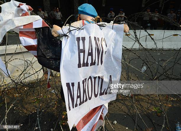 An effigy symbol of filmmaker Nakoula Basseley Nakoula is hung on barbed wire during a protest against a lowbudget US film insulting to Muslims...