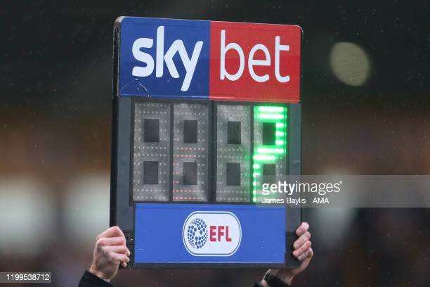 An EFL Sky Bet digital substitutions board is held up by the fourth official indicating two additional minutes of play during the Sky Bet League One...