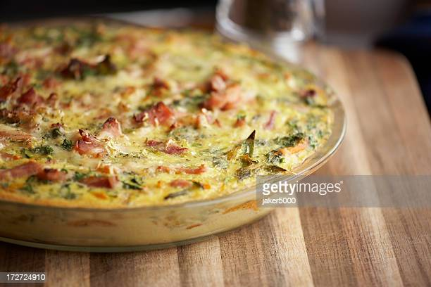 An egg and bacon frittata in a glass bowl