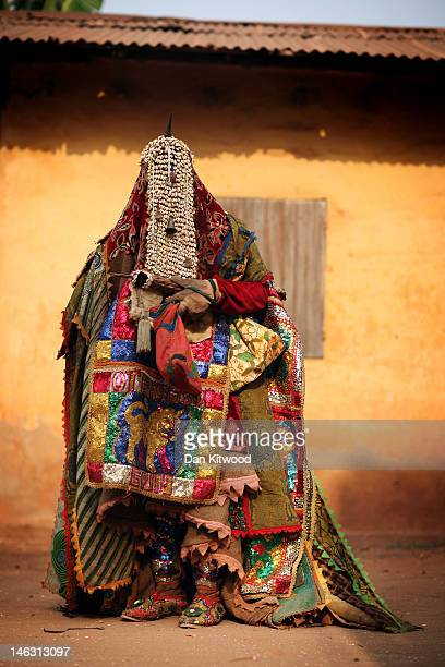 An 'Egungun' spirit from the Nigerian Yoruba Clan stands during a Voodoo ceremony on January 10 2012 in Ouidah Benin The Egungun are masqueraded...