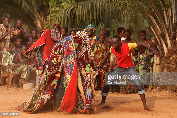 An 'Egungun' spirit performs during a Voodoo ceremony on January 10 2012 in Ouidah Benin The Egungun are masqueraded dancers that represents the...