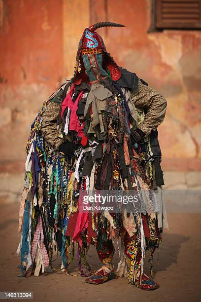 An 'Egungun' spirit stands during a Voodoo ceremony on January 10 2012 in Ouidah Benin The Egungun are masqueraded dancers that represents the...