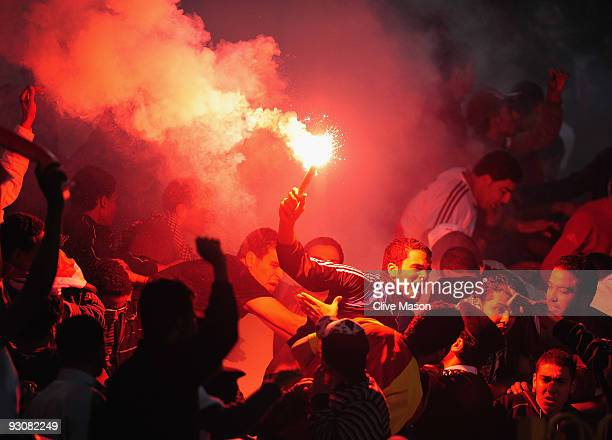 An Egypt fan celebrates Egypts second goal during the FIFA2010 World Cup qualifying match between Egypt and Algeria at the Cairo International...