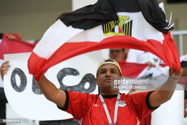 An Egypt fan holds the national flag before the Russia 2018 World Cup Group A football match between Saudi Arabia and Egypt at the Volgograd Arena in...