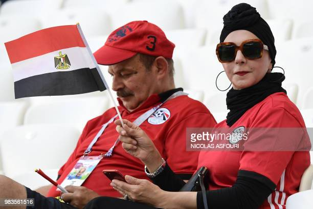 An Egypt fan holds the national flag before the start of the Russia 2018 World Cup Group A football match between Saudi Arabia and Egypt at the...