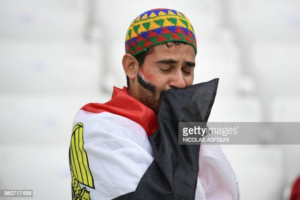 TOPSHOT An Egypt fan reacts after they lost the Russia 2018 World Cup Group A football match between Saudi Arabia and Egypt at the Volgograd Arena in...
