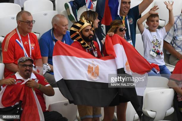 An Egypt supporter waves the national flag ahead of the Russia 2018 World Cup Group A football match between Saudi Arabia and Egypt at the Volgograd...