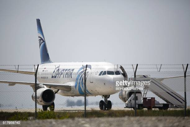 An EgyptAir Airbus A320 sits on the tarmac of Larnaca airport after it was hijacked and diverted to Cyprus on March 29 2016 A hijacker seized an...