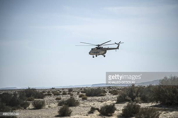 An Egyptian army helicopter flies over the crash site of an A321 Russian airliner in Wadi al-Zolomat, a mountainous area in Egypt's Sinai Peninsula,...