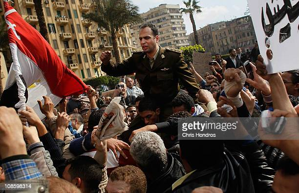 An Egyptian Army officer sympathizing with marchers is carried during an antigovernment protest in Tahrir Square January 30 2011 in Cairo Egypt As...