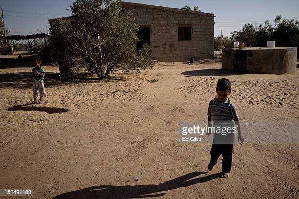 An Egyptian bedouin boy walks in front of a house in the village of Al Muqattah, in Egypt's restive North Sinai region, September 20, 2012. The...