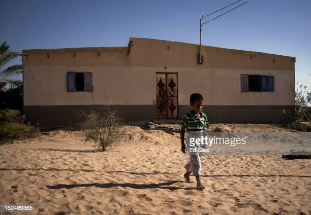 An Egyptian bedouin boy walks in front of his house in the village of Al Muqattah in Egypt's restive North Sinai region September 20 2012 The village...