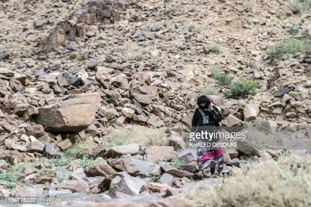 An Egyptian Bedouin woman guide from the Hamada tribe leads a group of hikers in Wadi elSahu in South Sinai governorate on March 29 during the first...