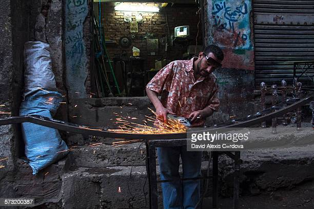 An Egyptian blacksmith is working the steel in the slum district of Manshiyat Nasser in Cairo