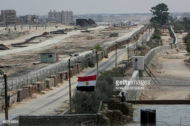 An Egyptian border guard stands at his post monitoring the border at Rafah between Egypt and the Palestinian Gaza Strip on August 19 2008. According...