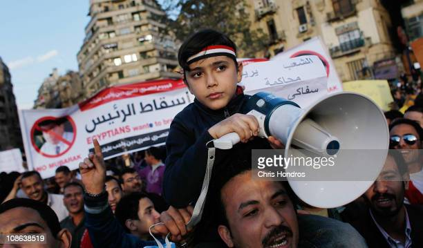 An Egyptian boy holds a megaphone while chanting antigovernment slogans in Tahrir Square the afternoon of January 31 2011 in central Cairo Egypt...