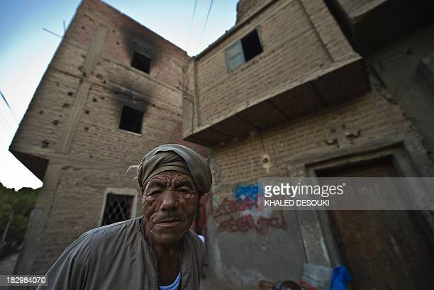 An Egyptian Coptic Christian man stands in front of his house in the town of Delga in the central Egyptian province of Minya some of 400 kilometres...