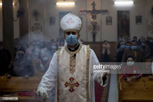 An Egyptian Coptic priest holds Christmas Eve mass at the Coptic Catholic St. Mark Church in Minya city, some 245 kilometres south of the capital...