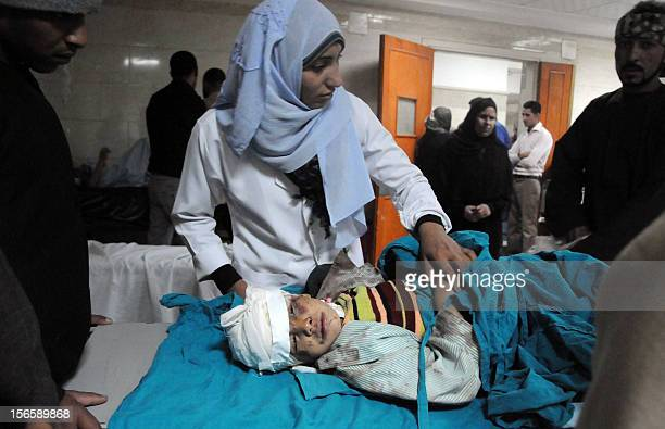 An Egyptian doctor attends to a wounded child at a hospital in Assiut on November 17 who was injured when a train smashed into a school bus on a...