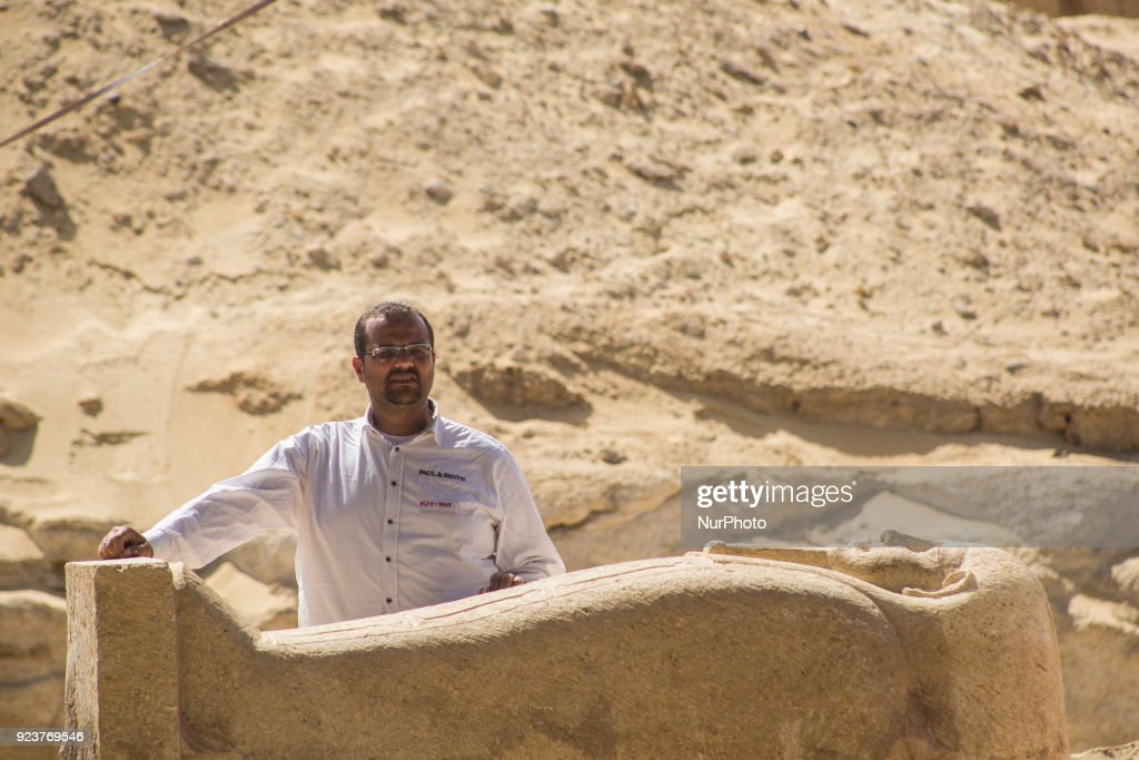 An Egyptian excavation worker works on a finding at a newly discovered cemetery, dating to the late pharaonic period and early Ptolemaic era, in Minya city, Southern Egypt, 24 February 2018. According to the Ministry of Antiquities, an ancient Egyptian cemetery was discovered six kilometers north of Tuna al-Gabal archaeological site in Minya, containing a number of burial shafts dating to the late pharaonic period and early Ptolemaic era. The archaeological mission unearthed a mummy decorated with a bronze collar, 1000 figurines, some 40 sarcophagi, four canopic jars, and other funerary items.