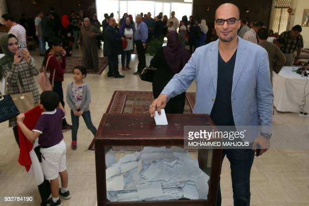 An Egyptian expatriate living in Oman casts his ballot for the Egyptian presidential elections at the Egyptian embassy in Muscat on March 16 2018...