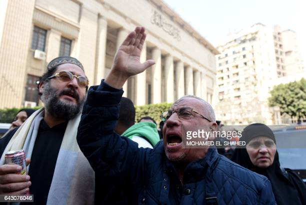 An Egyptian family member of a victim of the Port Said massacre reacts outside the Court of Cassation following the court's ruling in the case in...