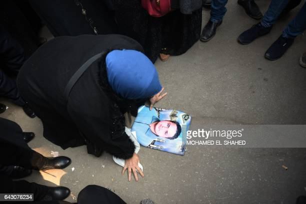 TOPSHOT An Egyptian family member of a victim of the Port Said massacre reacts outside the Court of Cassation following the court's ruling in the...