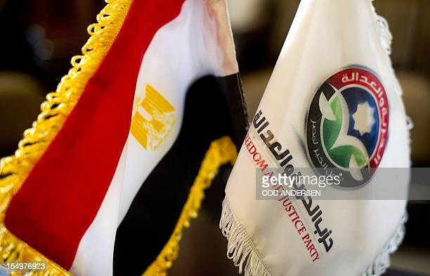 An Egyptian flag is placed next to the flag of the Freedom and Justice Party at the party headquarters in Cairo on November 30 2011 The FJP a front...