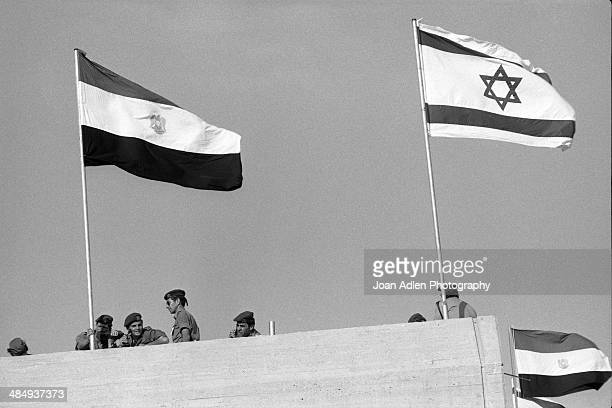 An Egyptian flag waves alongside Israel's flag during peace talks held at BenGurion University of the Negev led by Prime Minister of Israel Menachem...