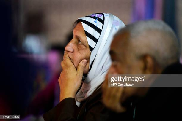 An Egyptian football fan reacts while watching from the outskirts of Cairo the CAF Champions League final football match between Egypt's AlAhly and...