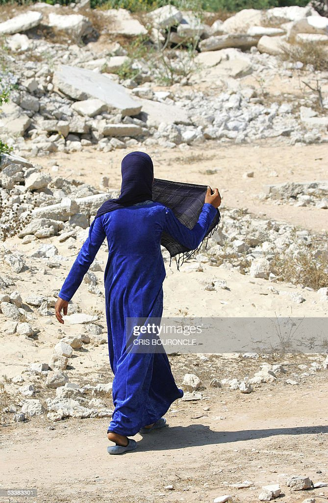 An Egyptian girl from the village of Abu Shinar in Sinai, 350 kilometers northeast of Cairo, close to the border with the Gaza Strip, walks 12 August 2005 in a path amid the ruins of the Israeli settlement of Yamit, which was evacuated and demolished in 1982 after the 1979 Camp David peace treaty. With Israel on the brink of evacuating its settlements in the Gaza Strip, the demolished ruins of Yamit serve as a harsh example of what the Gaza settlements could look like after the pull out.