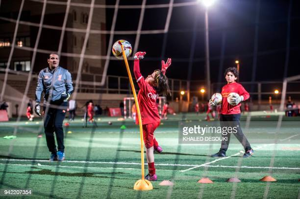 An Egyptian girl takes part in a training session at the Liverpool International Academy in the modern new city of Madinaty 40 kms east of the...