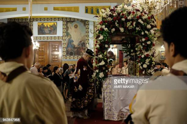 An Egyptian Greek Orthodox priest performs the Good Friday service by the catafalque containing the epitaph at the Greek Orthodox Church of the...