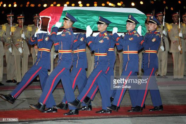 An Egyptian honour guard carries the casket bearing the remains of Palestinian leader Yasser Arafat November 11, 2004 at Cairo International Airport...