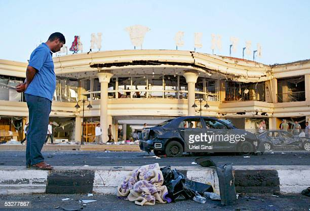 An Egyptian looks at a burntout car at the scene of a car bombing that wrecked a shopping mall July 23 2005 in the Egyptian Red Sea resort of Sharm...