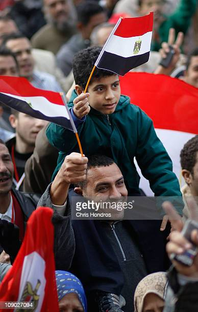 An Egyptian man and boy celebrate the resignation of Egyptian president Hosni Mubarak in Tahrir Square February 12, 2011 in Cairo, Egypt. Crowds...