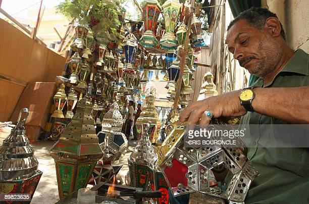 An Egyptian man assembles traditional tin lanterns known as Fawanis used by Egyptians to decorate during the fasting month of Ramadan in Cairo on...