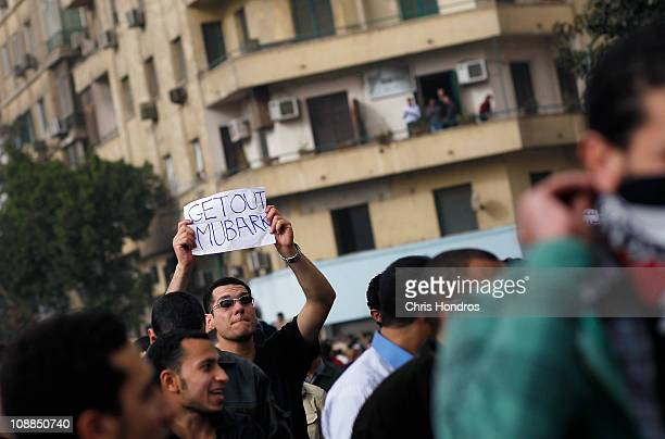 An Egyptian man carries a sign during a demonstration against President Hosni Mubarek in Tahrir Square March 21, 2010 in Cairo, Egypt. Unrest...