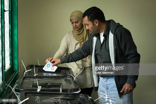 An Egyptian man casts his vote in a ballot box in the Egyptian constitutional referendum, held on the 14th and 15th of January 2014.