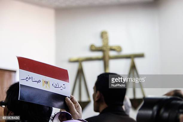 An Egyptian man celebrates with a national flag defaced with the words quotTiranquot and quotSanafirquot after the High Administrative Court upheld...