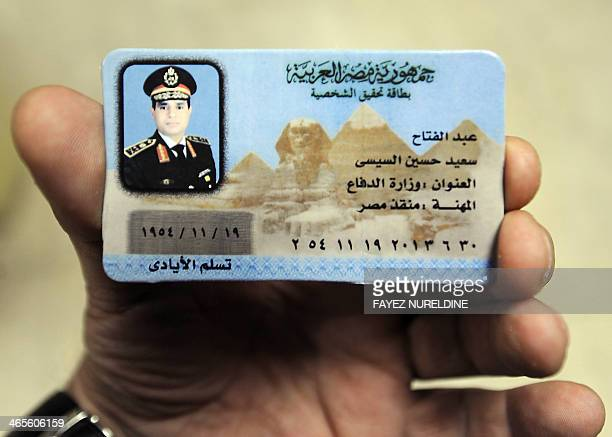 An Egyptian man displays a fake ID of Egypt's army chief Field Marshal Abdel Fattah alSisi which is being sold in the streets of Cairo as part of...