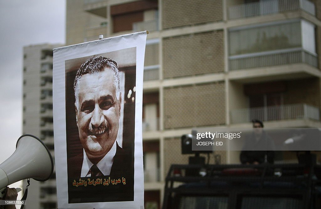 An Egyptian man holds up a poster of for : News Photo